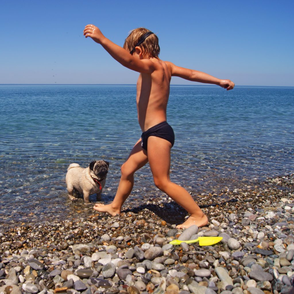 Boy with Pug in Lake cropped