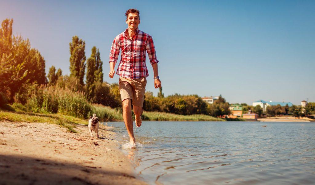 Man on Beach with Pug